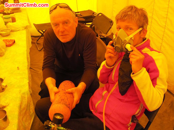 Kieran Lally and Monika Witkowska trying on the oxygen apparatus in basecamp. Scott Smith Photo.