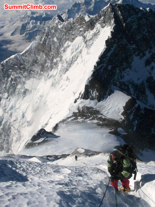 Mingma Sherpa climbs to the balcony. The South Col is below in Lhotse in the background. Photo by Monika Witkowska.