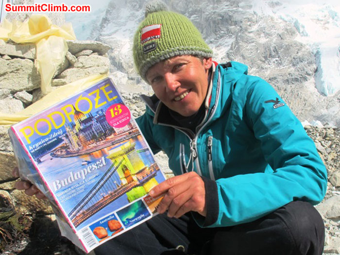 Monika Witkowska poses in basecamp with the magazine she writes and photographs for. Kieran Lally Photo.JPG
