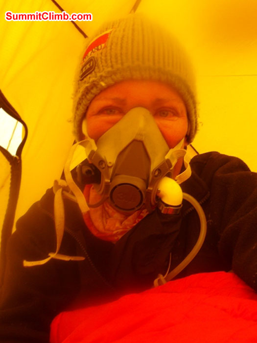 Monika Witkowska trying on her oxygen mask at the south col. Self Photo.