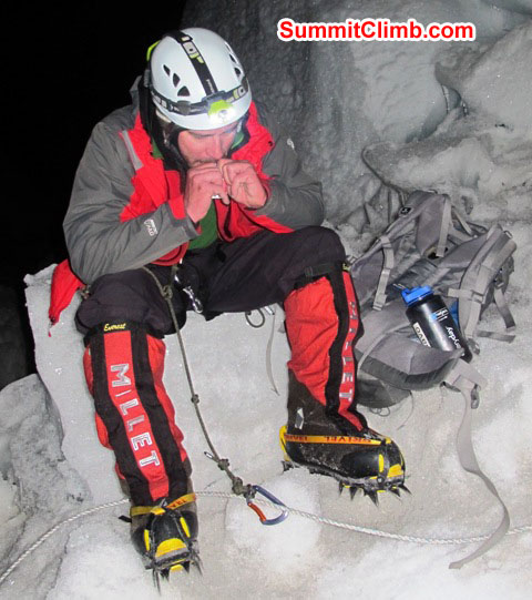 Slavomir Fila puts on his crampons at night at the 'crampon point' in the Khumbu icefall. Monika Witkowska Photo.