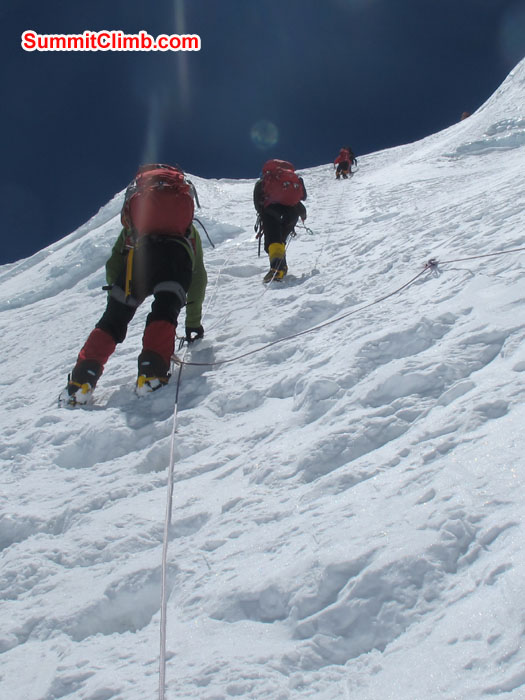 Member using fixed rope while climbing up NorthCol. Photo Chris Bailley