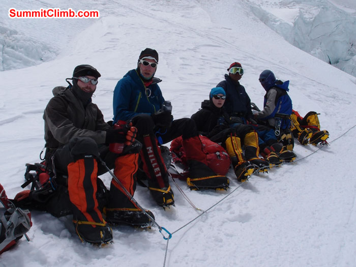 Just below North Col, members resting, Chris Bailley, David O'Brien, Rikke Hojland, Nganga Nuri Sherpa and Gelje Sherpa. Photo Martin.