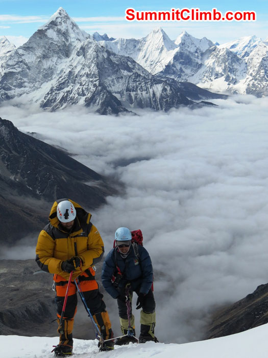Elmo Francis and Tenji Sherpa taking the Everest Nepal Training Climb 'Above the Clouds'. Mount Ama Dablam in the background.Photo by David Maidment