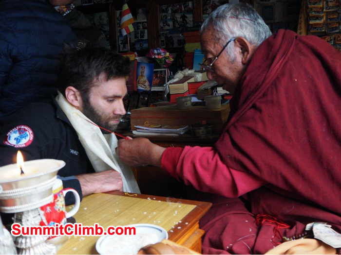 Everest Climbing member  receiving a blessing from the local Buddhist Lama in Pangboche.