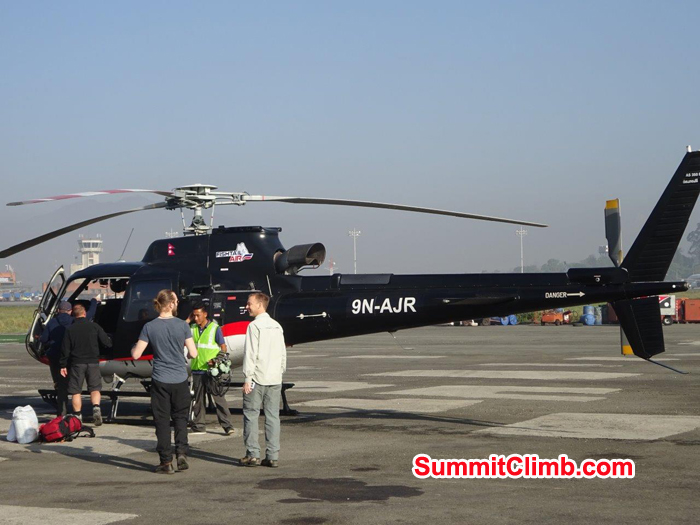 Everest Members ready to take off from heli to Lukla.  Photo Jeff Sorrel
