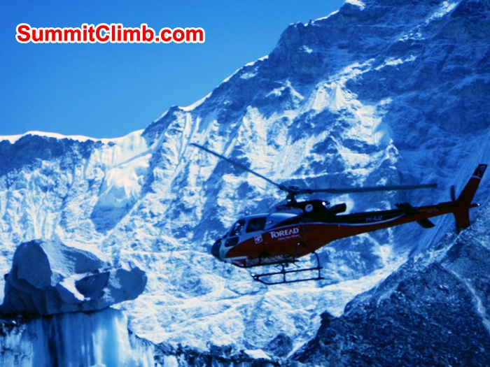 Helicopter taking off in basecamp. Mike Fairman Photo