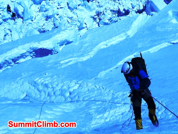 Les Binns from Yorkshire abseiling the face into the Khumbu Icefall, team members below. Mike Fairman Photo