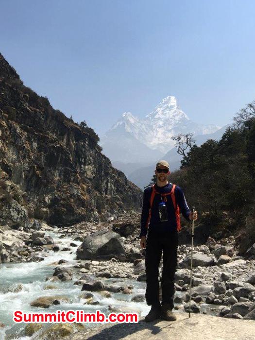 Member posing behind AmaDablam and follow river Dudh Koshi