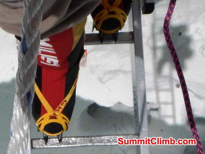Mike Fairman crosses a ladder in the Khumbu Icefall.