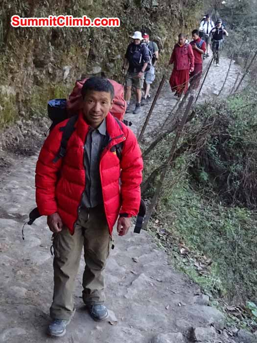 Mingma sherpa leading the climb members on the way to Namche Bazaar. photograph by James Grieve
