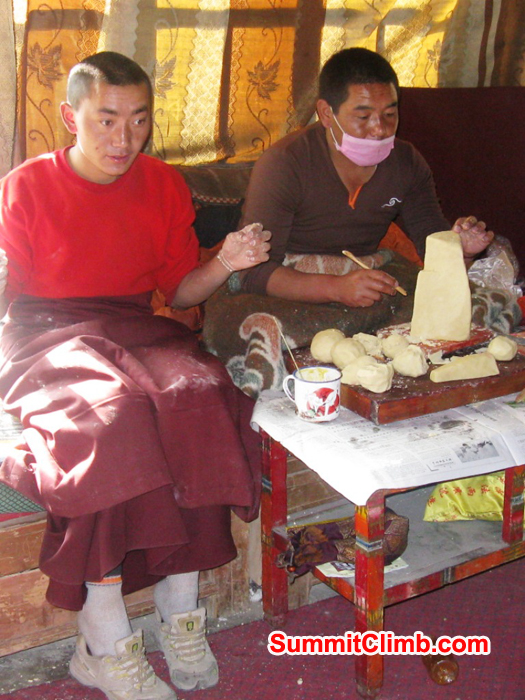 Monks in the Rongbuk Monastery carving butter sculptures