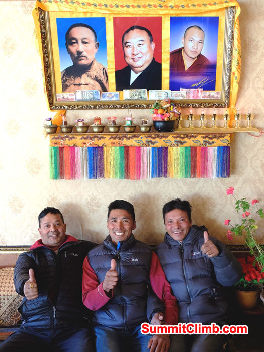 Murari, Dorje, and Tenji Sherpa in Tingri, Tibet with RAB jackets and 3 lamas.