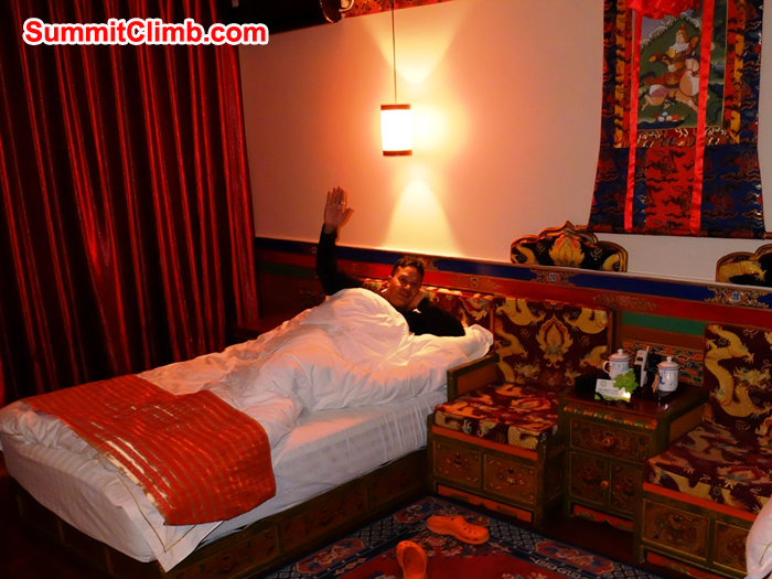 Murari Sharma relaxing in comfortable Shigatse hotel room