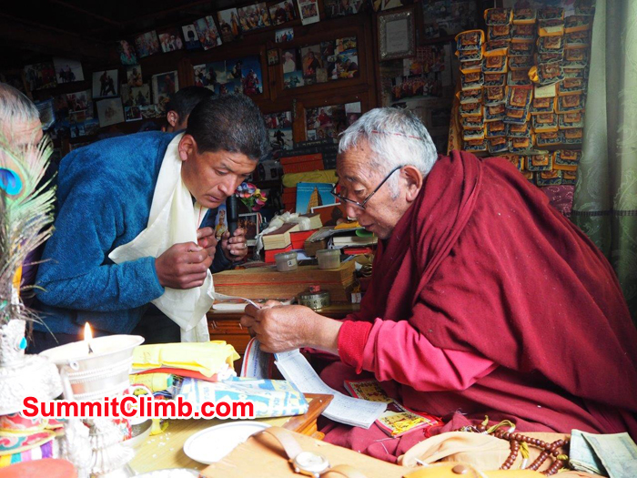 Our sherpa  receiving a blessing from the local Buddhist Lama in Pangboche.