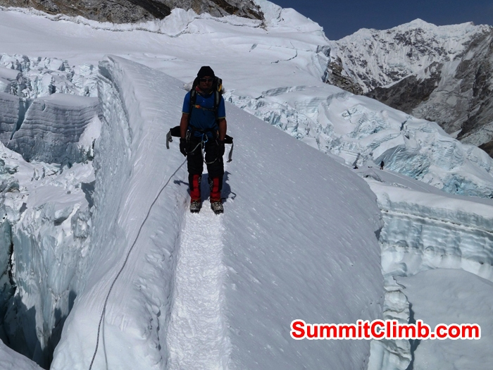 Sange Sherpa descending into the icefall. Franz Ruehrlinger Photo