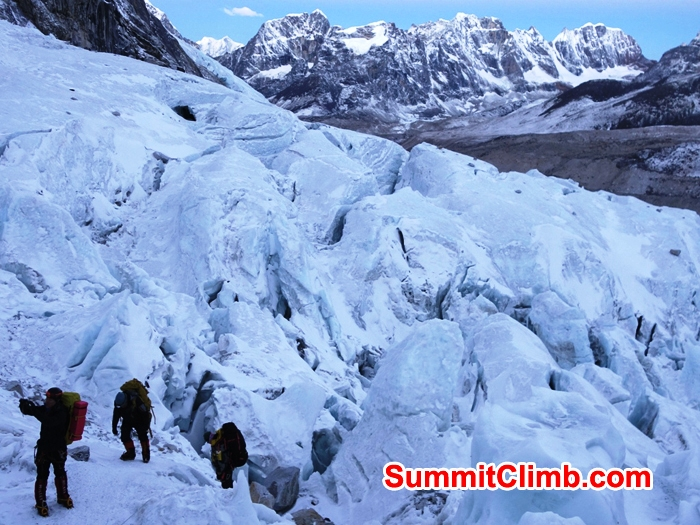 Team climbing up the Khumbu iceall. Mount Lobuche in background. Franz Ruehrlinger Photo