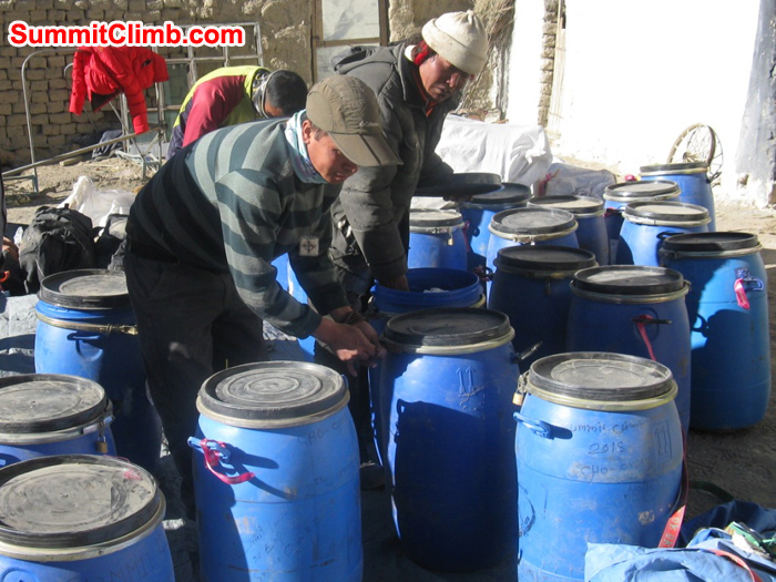 images/Everest/Tenji Dorje and Chimi sorting out our Cho Oyu and Shishapangma storage drums.JPG