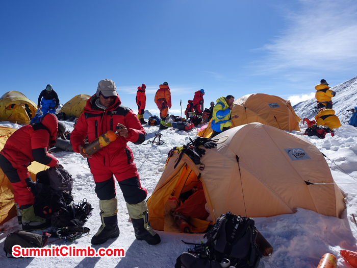 Tenji Sherpa checking oxygen bottles at Northcol. Photo Hubert Klaus