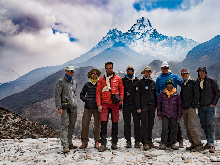 Everest Climber posing for photo during trek background Amadablam