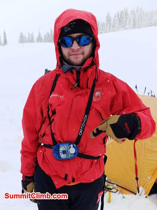 Ben points out his patroller avalanche beacon