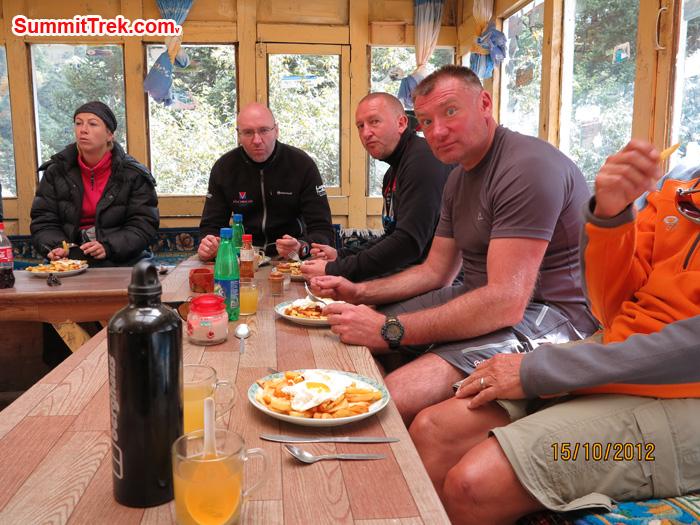 Member enjoying the food at cozy tea house. Photo Matthew Slater