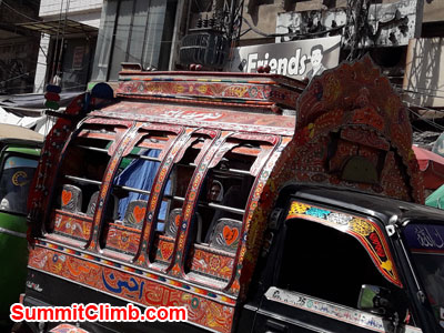 Decorated Suzuki passenger van in Raja Bazaar, Rawalpindi