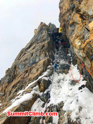 Tomaz snakes his way up houses chimney k2