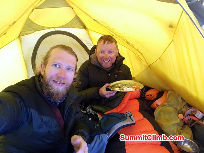 Members enjoying meals inside tent