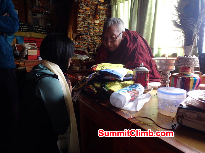 Everest Glacier Climbing member  receiving a blessing from the local Buddhist Lama in Pangboche.