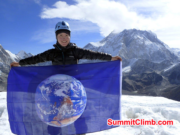 Summit of Lobuche Michiko Eto with World Flag