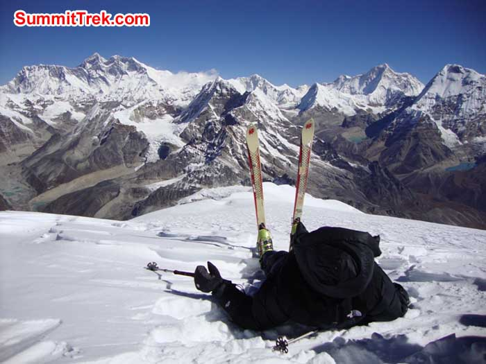 Resting and Peaks behind include Ama Dablam, Nuptse, Everest, Lhotse, Island Peak, Baruntse, Makalu and Chamlang