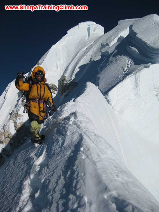 Jangbu Sherpa fixing rope on the Summit Ridge of Mount Baruntse. Photo Markus