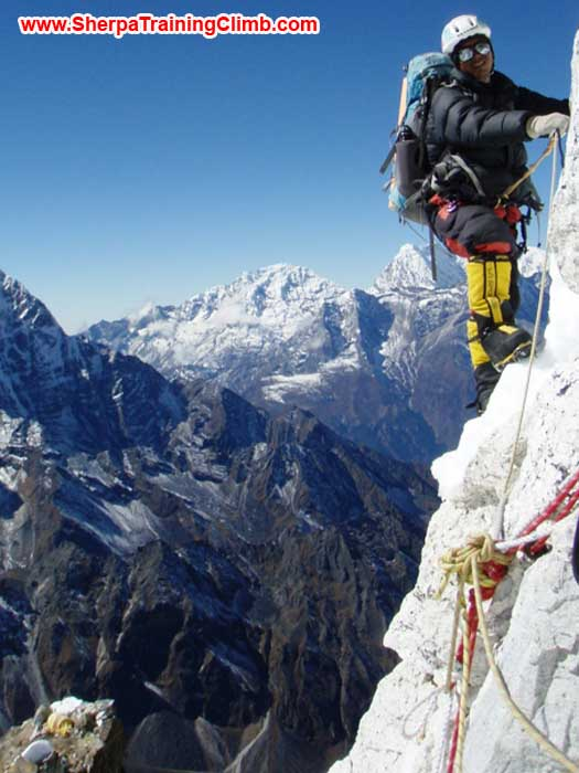 Gyelje Sherpa fixing rope in the lower part of the grey tower. Checkout camp two on top of the yellow tower in the lower left. photo by Maaike Braat