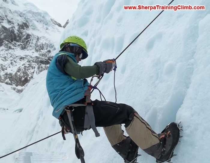 Beow Lim abseiling.