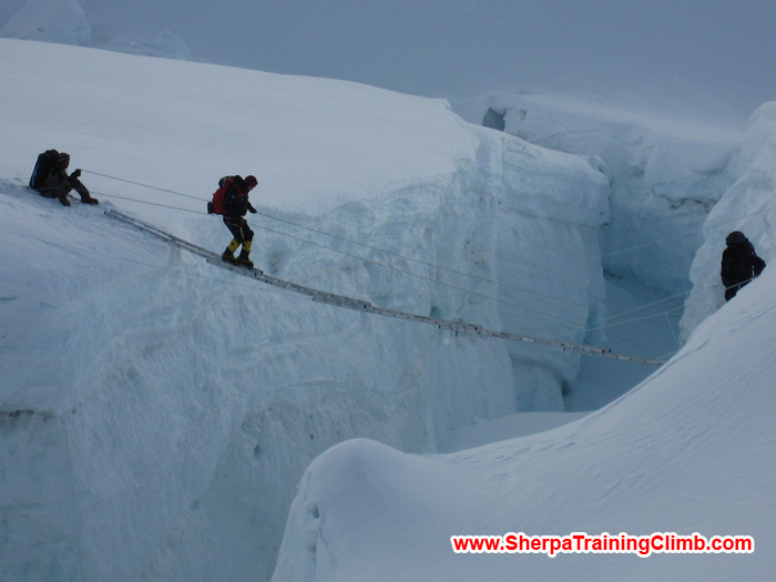 Sherpas helping a member to cross the Khumbu Ice fall. Photo Squash.