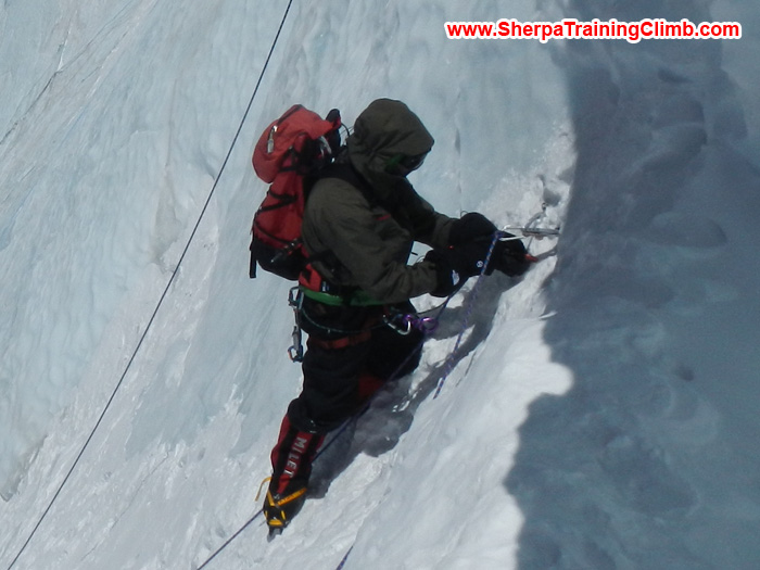 Sherpa fixing rope on Cho Oyu. Photo Mark.