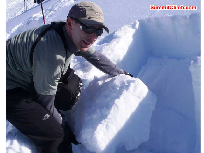 Victor Masny conducting a shear test on the snow pack, in order to see at which layer an avalanche might occur.