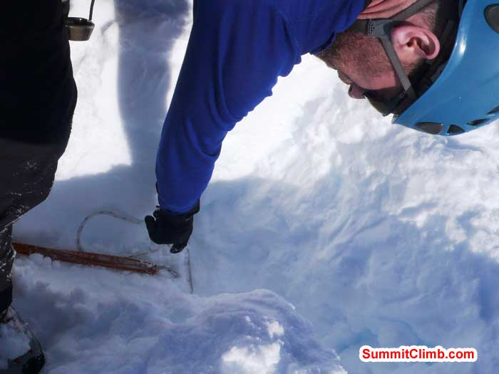 Ari Karchin demonstrates proper placement of a t-stake snow anchor.