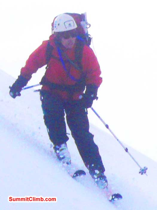 Tak Ogasawara, age 69, enjoying a ski run while the rest of us walk down.