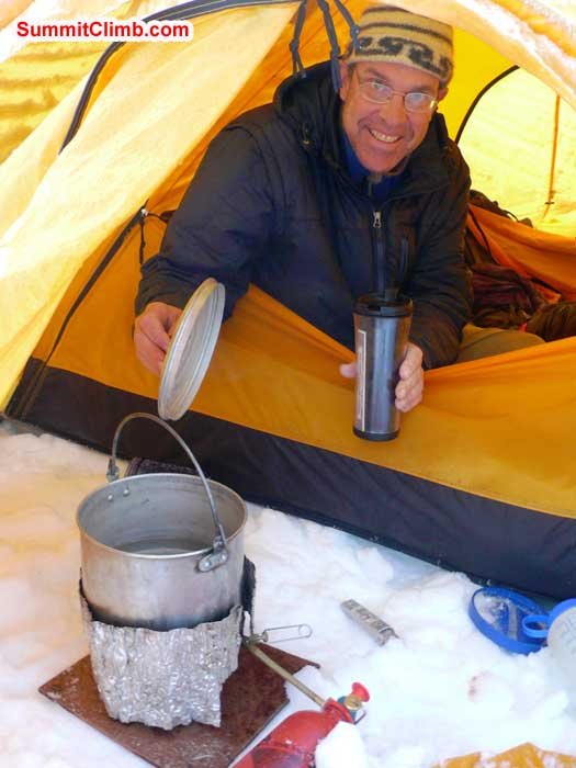 Dan making coffee in the warm tent.
