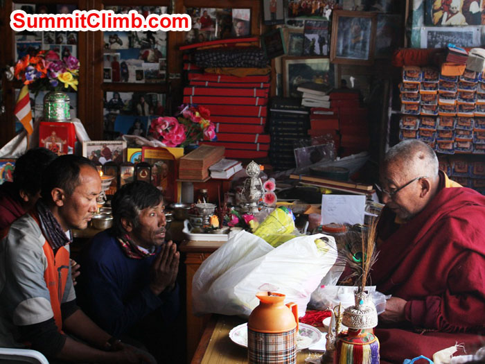 Thile Nuru Sherpa and Lakpa Kongle Sherpa being blessed by Lama Geshe. Photo by Sam Chappatte