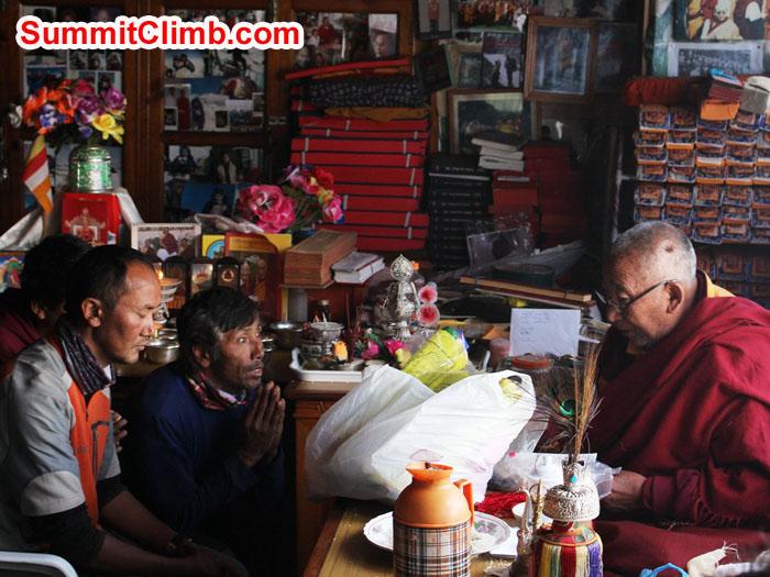 Thile Nuru Sherpa and Lakpa Kongle Sherpa being blessed by Lama Geshe. Photo by Sam Chappatte