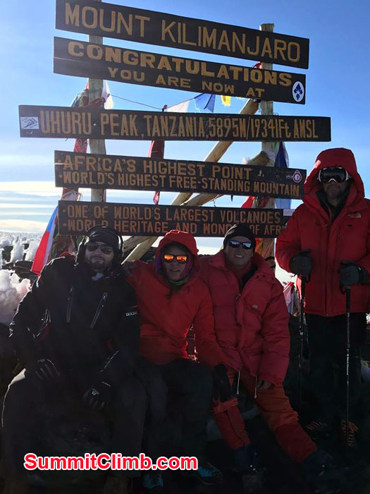 Team at the summit of Kilimanjaro