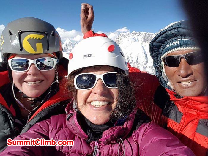 Holly, Carmen Larraz and Lakpa at the summit of AmaDablam