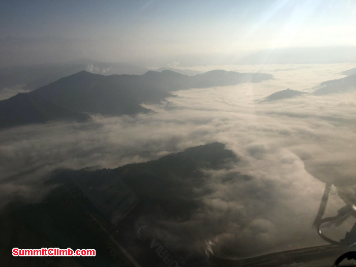 flying above the clouds while flying to Lukla airport via helicopter