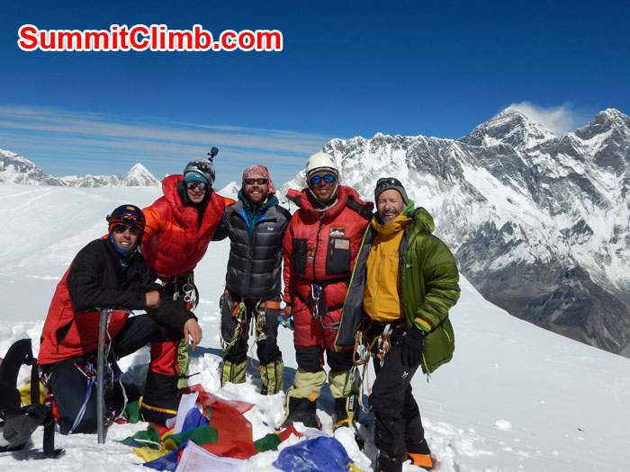 team at the summit of amadablam
