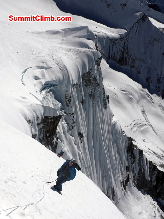 Gordon and Jangbu belay down from summit of Baruntse