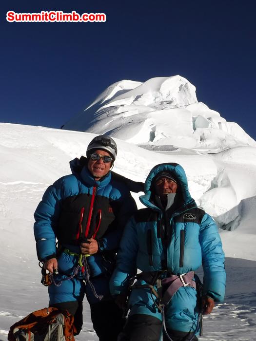 Gordon and Jangbu belay down from summit of baruntse. photo Gordon