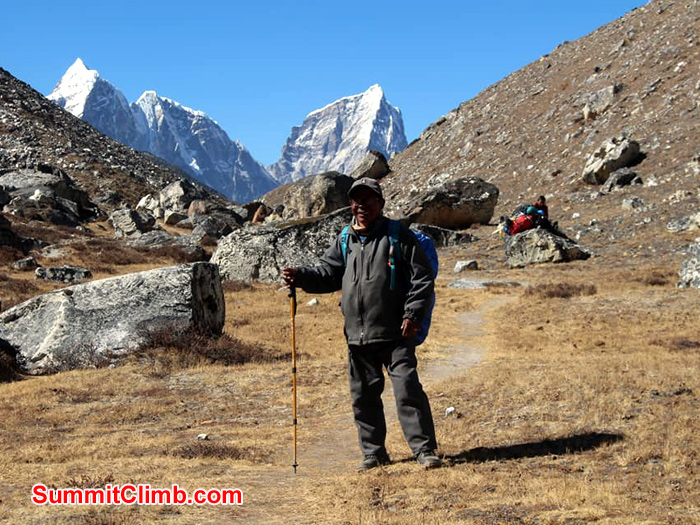 sherpa standing with stick